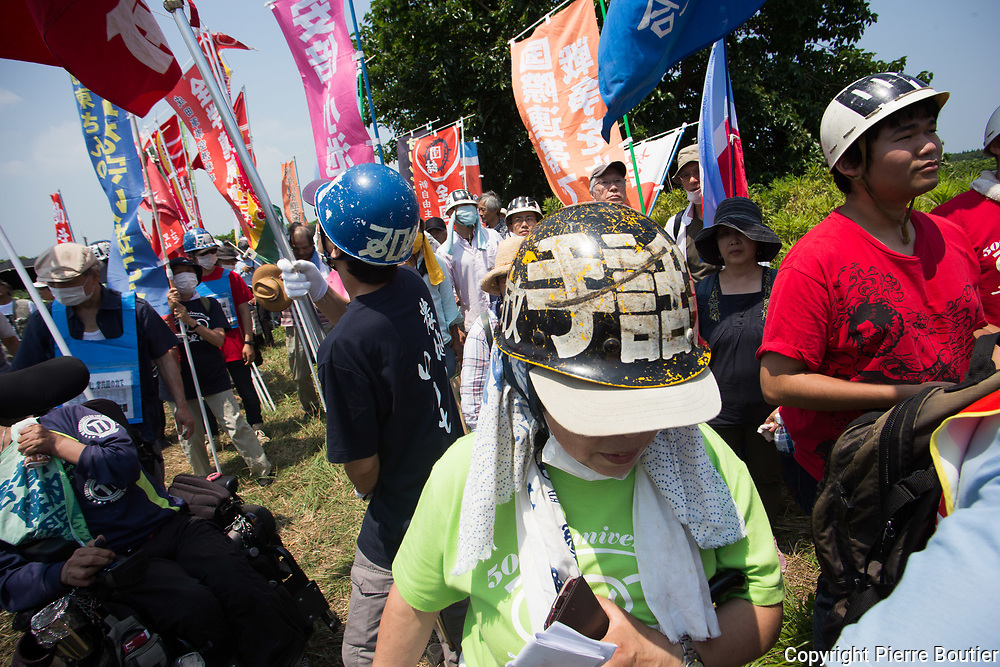 July 9,2017_Tokyo,Chiba   farmers and revolutionnary leagues fighting against the expropriation of their land by Narita airport company who want to expand the land of airport . 50 years after the first actions of resistance, and a long  struggle where there were more than 6500 wounded and 3300 arrests and two deaths in confrontations with the police anti Riots, groups from the new left, such as the Zengakuren, the farmers' league, the communist league, anarchist groups are gathering on the plots of Sir Takao Ito who continues to fight against his expropriation. Pierre Boutier,