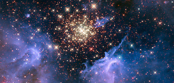 July 3, 2018 - Space - Like a July 4 fireworks display, a young, glittering collection of stars resembles an aerial burst. The cluster is surrounded by clouds of interstellar gas and dust, the raw material for new star formation. The nebula, located 20,000 light-years away in the constellation Carina, contains a central cluster of huge, hot stars, called NGC 3603. Appearing colorful and serene, this environment is anything but. Ultraviolet radiation and violent stellar winds have blown out an enormous cavity in the gas and dust enveloping the cluster. Most of the stars in the cluster were born around the same time but differ in size, mass, temperature and color. (Credit Image: © NASA/ZUMA Wire/ZUMAPRESS.com)