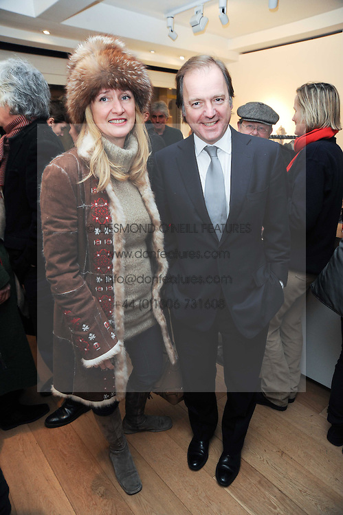 HUGO SWIRE MP and his wife SASHA at a private view of photographs by Nick Ashley held at the Sladmore Gallery, 32 Bruton Place, London on 13th January 2010.
