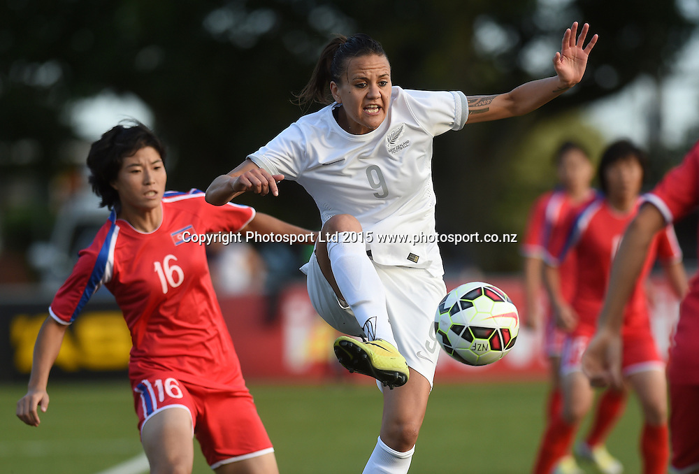 New Zealand's Amber Hearn and Korea's Wijong Sim. Womens Football. New Zealand Football Ferns v Korea DPR. Auckland, New Zealand. Sunday 8 February 2015. Copyright Photo: Andrew Cornaga / www. Photosport.co.nz