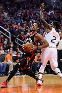 Dec 29, 2016; Phoenix, AZ, USA;  Toronto Raptors guard DeMar DeRozan (10) drives the ball by Phoenix Suns guard Eric Bledsoe (2) in the first half of the NBA game at Talking Stick Resort Arena. Mandatory Credit: Jennifer Stewart-USA TODAY Sports