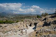 A couple visits  Mycenae near Nafplion, Greece.
