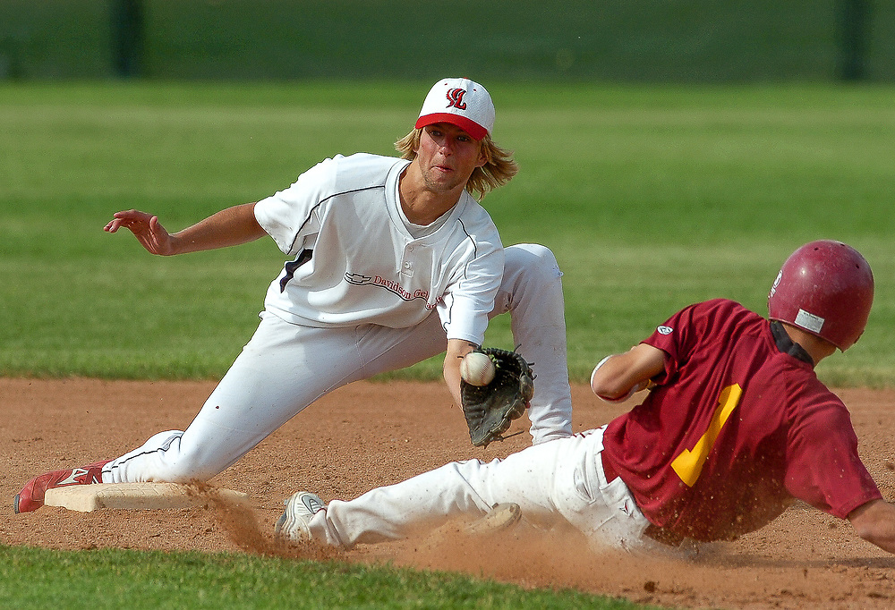 Loveland shortstop Kris Ratschkowsky prepares to tag out a Rocky Mountain base runner attempting to steal second base, July 1, 2008. Loveland defeated Rocky Mountain Tuesday afternoon.