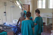 Doctors prepare for a caesarean section in the main theatre at   Kasangati Health Centre in Uganda.
