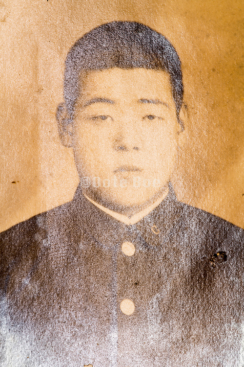 extreme silver mirroring on a portrait of a young boy in school uniform Japan ca 1930s