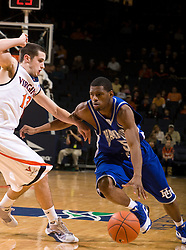 Hampton guard Brandon Tunnell (5) tries to dribble past Virginia guard Sammy Zeglinski (13).  The Virginia Cavaliers defeated the Hampton Pirates 74-48 at the John Paul Jones Arena on the Grounds of the University of Virginia in Charlottesville, VA on December 23, 2008. (Special to the Daily Progress / Jason O. Watson)