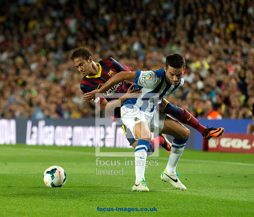Picture by Cristian Trujillo/Focus Images Ltd +34 64958 5571<br /> 24/09/2013<br /> Neymar of FC Barcelona and a defender of Real Sociedad during the La Liga match at Camp Nou, Barcelona.