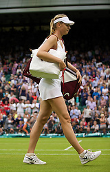 LONDON, ENGLAND - Saturday, June 28, 2014: Maria Sharapova (RUS) walks off court after winning the Ladies' Singles 3rd Round match 6-3, 6-0 on day six of the Wimbledon Lawn Tennis Championships at the All England Lawn Tennis and Croquet Club. (Pic by David Rawcliffe/Propaganda)