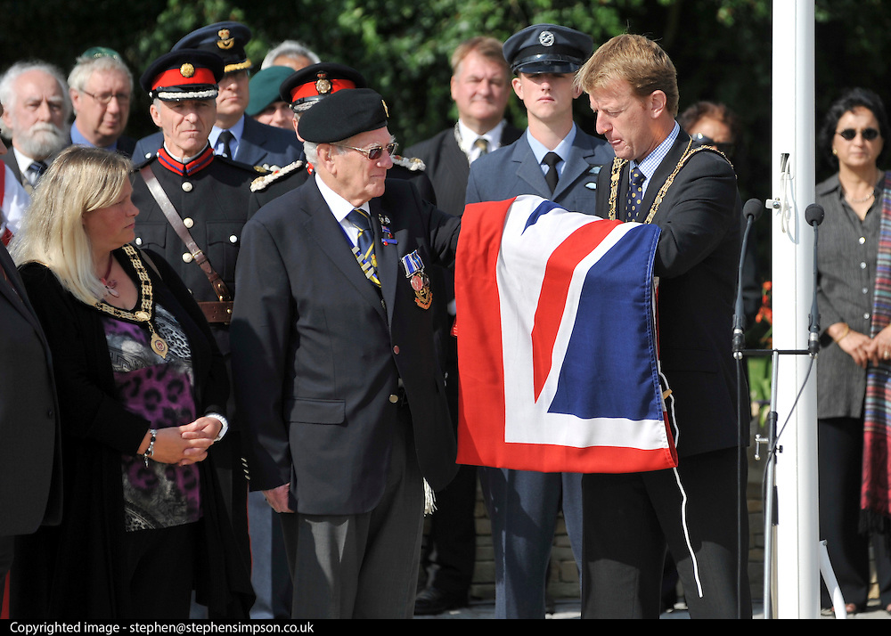 © licensed to London News Pictures. CARTERTON, UK.  01/09/11. The Town Mayor of Wootton Bassett, Cllr Paul Heaphy prepares to hand over the flag. A ceremony, attended by British Prime Minister David Cameron,  takes place at The Memorial Garden at Norton Way in Carterton, Oxfordshire today (01 Sept 2011). The Garden will become the focal point during the repatriation of UK service personnel from RAF Brize Norton. The Union Flag that used to fly at repatriations in Wooton Bassett was handed over and was blessed. . Mandatory Credit Stephen Simpson/LNP