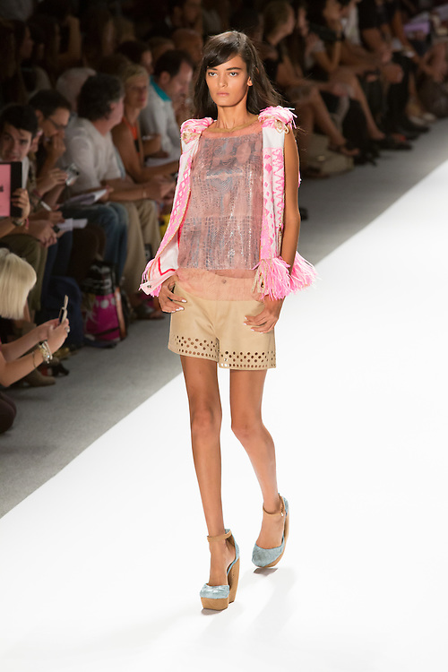 Shorts with eyelet hem, sparkly top and white and pink vest. By Custo Barcelona at the Spring 2013 Fashion Week show in New York.