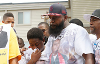 Michael Brown Sr., at the spot where his son was killed comforts his wife Cal Brown during 4 1/2 minutes of silence to mark the one year anniversary of the killing of son Michael Brown Jr. in Ferguson, Missouri August 9, 2015.  Several hundred people gathered in Ferguson, Missouri, on Sunday to mark the one-year anniversary of the shooting death of an unarmed black teenager by a white police officer that sparked protests and a national debate on race and justice.  REUTERS/Rick Wilking