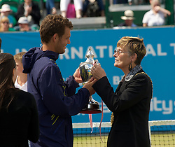 LIVERPOOL, ENGLAND - Saturday, June 19, 2010: Men's Champion Paul-Henri Mathieu (FRA) is presented with the trophy by Lord Mayor of Liverpool Councillor Hazel Williams during the Men's Singles Final on day four of the Liverpool International Tennis Tournament at Calderstones Park. (Pic by David Rawcliffe/Propaganda)