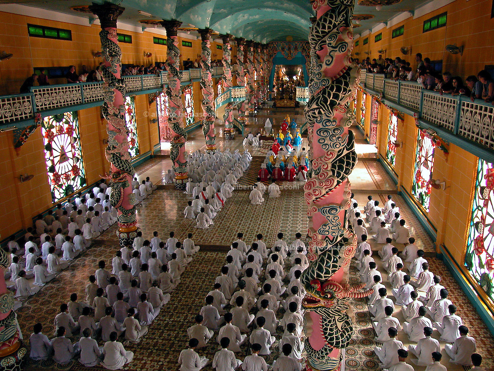 Vietnam, :  mess in the caodaist church. Vietnam, Tay Ninh, The Caodai religion (Caodaism) is a mix of religious beliefs from the..West and the East, including aspects of Buddhism, Confucianism, Taoism,..Vietnamese spiritism, Christianity, and Islam