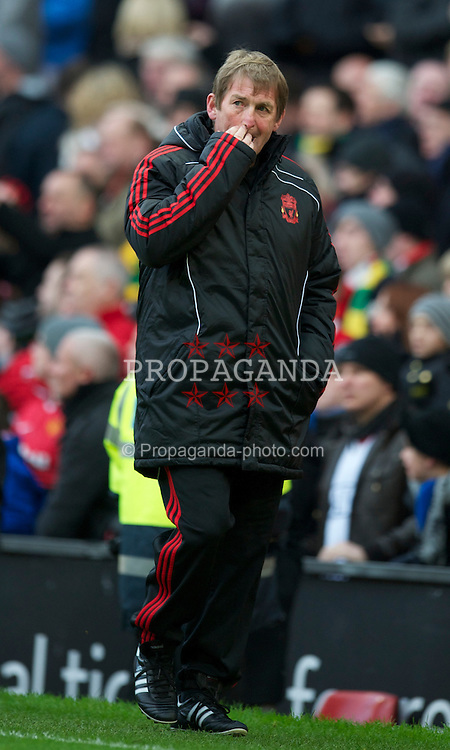 MANCHESTER, ENGLAND - Sunday, January 9, 2011: Liverpool's manager Kenny Dalglish MBE leaves the field at half time as his ten men trail Manchester United 1-0 during the FA Cup 3rd Round match at Old Trafford. (Photo by: David Rawcliffe/Propaganda)