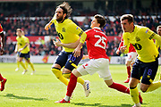Blackburn Rovers forward Danny Graham (10) is fouled by Nottingham Forest's Sam Byram (25) during the EFL Sky Bet Championship match between Nottingham Forest and Blackburn Rovers at the City Ground, Nottingham, England on 13 April 2019.