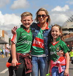 James and Sinead Hughes with Clodagh Ruddy Mayo supporters from <br /> on their way to the Croke park for the All Ireland quarter final replay<br /> Pic Conor McKeown