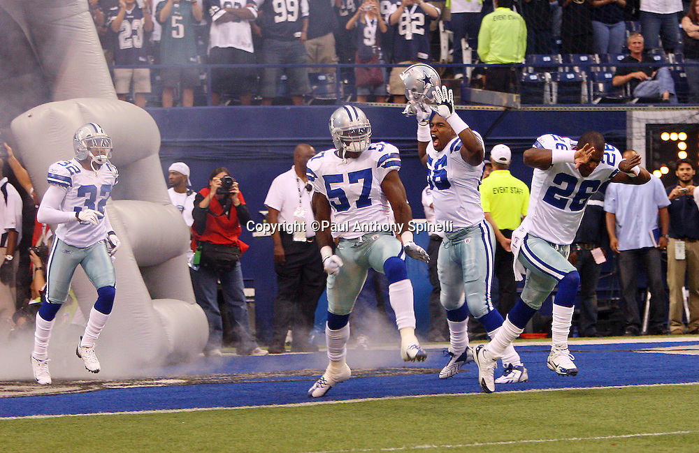 IRVING, TX - SEPTEMBER 15:  A group of Dallas Cowboys players celebrate as they run onto the field before the game against the Philadelphia Eagles at Texas Stadium on September 15, 2008 in Irving, Texas. The Cowboys defeated the Eagles 41-37. ©Paul Anthony Spinelli