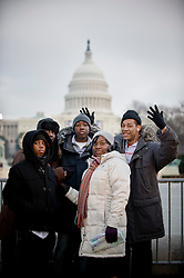 A family from Atlanta, Georgia pose in front of the Capitol in Washington DC ahead of the inauguration of Barack Obama as the 44th President of the United States of America January 20, 2009 in Washington, DC. Before a crowd of more than a million, Obama became the first African-American to be elected to the office of President in the history of the United States. On an extraordinary day in the life of America, people waited for hours in frigid temperatures to witness this historic inauguration.  (Ami Vitale)