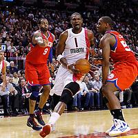 21 January 2012: Miami Heat power forward Chris Bosh (1) drives past Philadelphia Sixers small forward Andre Iguodala (9) and Philadelphia Sixers power forward Lavoy Allen (50) during the Miami Heat 113-92 victory over the Philadelphia Sixers at the AmericanAirlines Arena, Miami, Florida, USA.