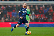 Leeds United midfielder Adam Forshaw (4) in action  during the EFL Sky Bet Championship match between Stoke City and Leeds United at the Bet365 Stadium, Stoke-on-Trent, England on 19 January 2019.