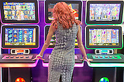 UNITED KINGDOM, London: 02 February 2016 A visitor to this years ICE Totally Gaming Convention plays on electronic gambling machines at the Excel Arena, East London. The three day event is the world's premier international expo for gaming and gambling professionals. Rick Findler / Story Picture Agency