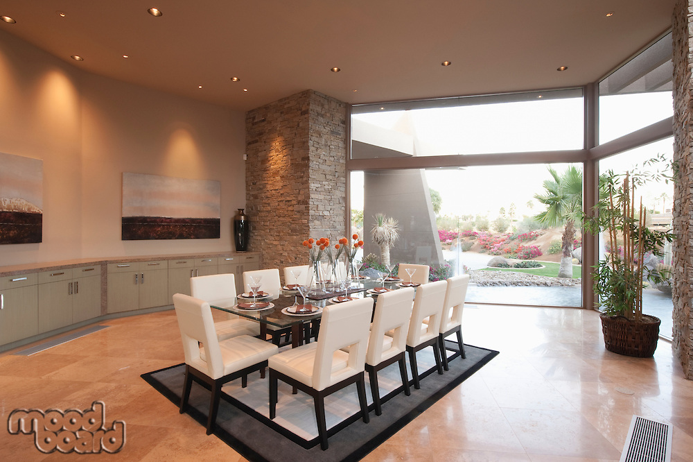 Spacious dining room and kitchen with floor to ceiling windows