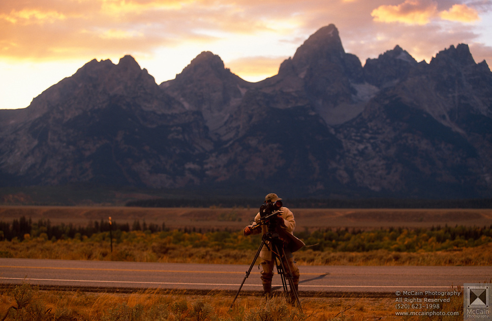 Videographer taping storm, Grand Teton National Park, near Moose, Wyoming..Subject photograph(s) are copyright Edward McCain. All rights are reserved except those specifically granted by Edward McCain in writing prior to publication...McCain Photography.211 S 4th Avenue.Tucson, AZ 85701-2103.(520) 623-1998.mobile: (520) 990-0999.fax: (520) 623-1190.http://www.mccainphoto.com.edward@mccainphoto.com