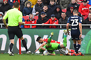 Kiko Casilla (33) of Leeds United is squashed by Bailey Wright (5) of Bristol City during the EFL Sky Bet Championship match between Bristol City and Leeds United at Ashton Gate, Bristol, England on 9 March 2019.
