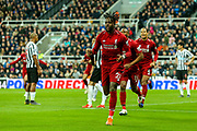 Divock Origi (#27) of Liverpool celebrates Liverpool's third goal (2-3) during the Premier League match between Newcastle United and Liverpool at St. James's Park, Newcastle, England on 4 May 2019.