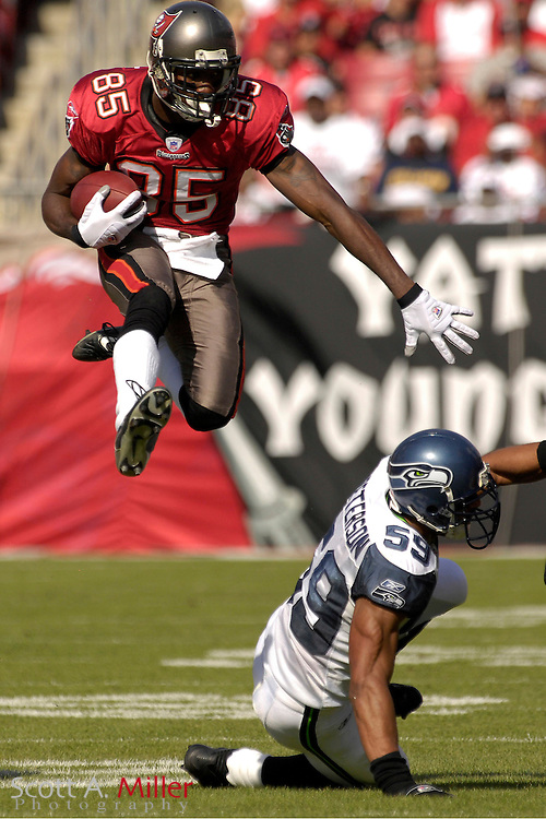 Tampa Bay Buccaneers receiver (85) Maurice Stovall hurdles Seattle Seahawks defender (59) Julian Peterson during their game against the  Tampa Bay Buccaneers at Raymond James Stadium on Dec. 31, 2006 in Tampa, Florida......©2006 Scott A. Miller