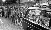 Children follow the hearse containing the little white coffin 3 year old Michelle O'Connor, who died when a UDA/UFF booby trap bomb exploded when she was getting into the family car along with her father, John O'Connor, who received very serious injuries but survived. Michelle was being taken to nursery school. The incident took place on 13th June 1975. The funeral on 16th June 1975 was from the Holy Rosary Church on the Ormeau Road, Belfast, and was attended by hundreds of Protestants as well as Roman Catholics. No reason could be found for the attack other than sectarianism. 197506160497b<br /> <br /> Copyright Image from Victor Patterson, 54 Dorchester Park, Belfast, UK, BT9 6RJ<br /> <br /> t1: +44 28 9066 1296 (from Rep of Ireland 048 9066 1296)<br /> t2: +44 28 9002 2446 (from Rep of Ireland 048 9002 2446)<br /> m: +44 7802 353836<br /> <br /> victorpattersonbelfast@gmail.com<br /> victorpatterson@me.com<br /> <br /> www.victorpatterson.com<br /> <br /> Please see my Terms and Conditions of Use at victorpatterson.com. It is IMPORTANT that you familiarise yourself with them.<br /> <br /> Images used on the Internet incur an additional cost and must be visibly watermarked i.e. ©Victor Patterson within the body of the image and copyright metadata must not be deleted. Images used on the Internet have a size restriction of 4kbs and are chargeable at rates available at victorpatterson.com.<br /> <br /> This image is available only for the use of the download recipient i.e. television station, newspaper, magazine, book publisher, etc, and must not be passed on to any third party. It is also downloaded on condition that each and every usage is notified within 7 days to victorpatterson@me.com<br /> <br /> The right of Victor Patterson (or the named photographer) to be identified as the author is asserted in accordance with The Copyright Designs And Patents Act (1988). All moral rights are asserted.