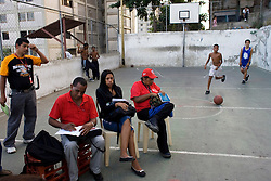 "Representatives of various Consejo Communales, or ""Community Councils"", hold a meeting on a basketball court in Calvario, a a poor slum in Caracas. These councils have become a center piece of Hugo Chavez's policy.  These groups meet a few times a month and discuss problems in the community and propose projects and solutions. They then take these proposals to the government who tries to oversee their completion."