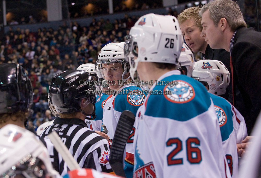 KELOWNA, CANADA, DECEMBER 27: Tanner Moar #23 listens to referee Steve Papp discuss a call with Kelowna Rockets coaches Ryan Cuthbert and Kim Dillabaugh at the Kelowna Rockets on December 7, 2011 at Prospera Place in Kelowna, British Columbia, Canada (Photo by Marissa Baecker/Getty Images) *** Local Caption ***