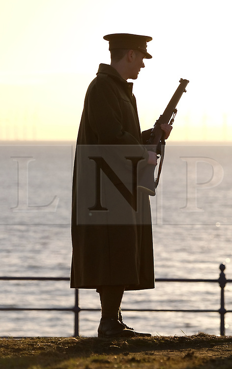 © Licensed to London News Pictures. <br /> 16/12/2014. <br /> <br /> Hartlepool, United Kingdom<br /> <br /> David Little a member of the Commemoration Society for the 18th Battalion The Durham Light Infantry poses in front of the lighthouse at Hartlepool Headland during an event to commemorate the bombardment of Hartlepool by German warships during World War One. During the bombardment 130 civilians were killed and more than 500 were wounded. The Headland's Heugh Gun Battery returned fire in what was the only battle to be fought on British soil during World War One, and one of the Battery's soldiers, Theo Jones of the Durham Light Infantry, became the first British soldier to be killed by enemy action on home ground in the war.<br /> <br /> Photo credit : Ian Forsyth/LNP