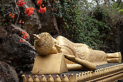 Luang Prabang, Laos. Buddhist statuary on Mount Phousi in the center of the town of Luang Prabang.