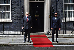 © Licensed to London News Pictures. 18/06/2020. London, UK. French President Emmanuel Marcon meets with British Prime Minister Boris Johnson at Downing St during a one day visit to celebrate the 80th anniversary of Charles de Gaulle's wartime appeal to the people of France to resist German occupation.<br />