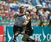 Fijian Captain Osea Kolinisau offloads the ball during the Hong Kong Sevens 2015 match between Fiji Sevens and *Belgium  Sevens at the Hong Kong Stadium, Hong Kong on 28 March 2015. Photo by Ian Muir....during the Hong Kong Sevens 2015 match between ........... at Hong Kong Stadium, Hong Kong on 27 March 2015. Photo by Ian Muir.