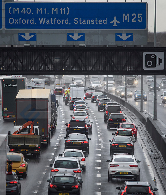© Licensed to London News Pictures. 20/12/2019. London, UK. Tailbacks on the M25 at junction 15 with the M4 as traffic battles through wet conditions at the start of the Christmas getaway. Photo credit: Ben Cawthra/LNP