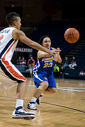 Morehead St. guard Anitha Smith-Williams (23) passes around Virginia guard Britnee Millner (12).  The Virginia Cavaliers women's basketball team defeated the Morehead State Eagles 88-43 at the John Paul Jones Arena in Charlottesville, VA on February 4, 2008.
