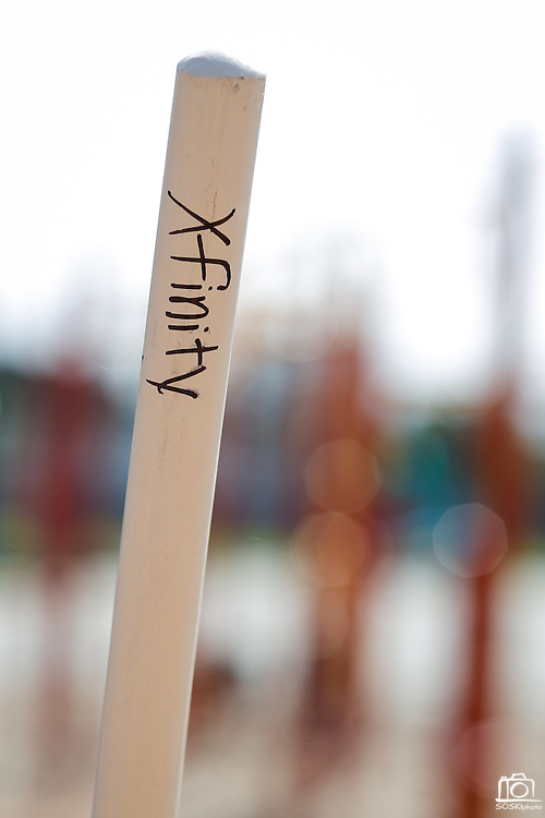"A rake handle is marked with ""Xfinity"" during Comcast Cares Day at Curtner Elementary School in Milpitas, California, on April 27, 2013. (Stan Olszewski/SOSKIphoto)"
