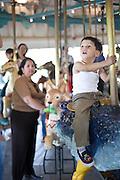 Michael Vasquez on Pullen Park's Carousel.