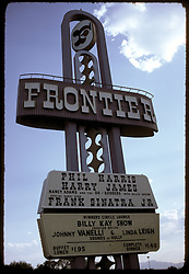 Las Vegas Strip, The Frontier Hotel and Casino Sign, headlining Frank Sinatra Jr, Harry James, Phil Harris on the sign. July 1973