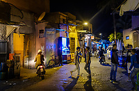 MARRAKESH, MOROCCO - CIRCA APRIL 2017: People wandering at night around the Boulevard Fatima Zahra in Marrakesh. This is a local area close to the Medina.