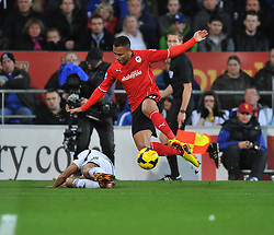 Swansea City's Neil Taylor tackles Cardiff City's Peter Odemwingie - Photo mandatory by-line: Alex James/JMP - Tel: Mobile: 07966 386802 03/11/2013 - SPORT - FOOTBALL - The Cardiff City Stadium - Cardiff - Cardiff City v Swansea City - Barclays Premier League