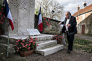 Parigny La Rose's mayer Nicolas Maurice, prepares the brand new memorial for the first armistice ceremony of WWI, on November 11, 2015 in Parigny la Rose. AFP PHOTO / JEFF PACHOUD