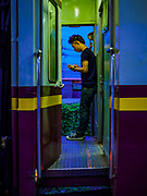 31 MAY 2017 - CHACHOENGSAO, THAILAND:  A passenger on the first train of the day at the train station in Chachoengsao, a provincial town about 50 miles and about an hour by train from Bangkok. The train from Chachoengsao to Bangkok takes a little over an hour but traffic on the roads is so bad that the same drive can take two to three hours. Thousands of Thais live outside of Bangkok and commute into the city for work on trains, busses and boats.      PHOTO BY JACK KURTZ