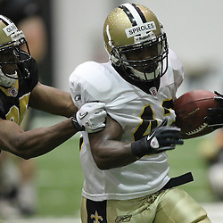 August 5, 2011; Metairie, LA, USA; New Orleans Saints running back Darren Sproles (43) runs past safety Paul Oliver (25) during training camp practice at the New Orleans Saints practice facility. Mandatory Credit: Derick E. Hingle
