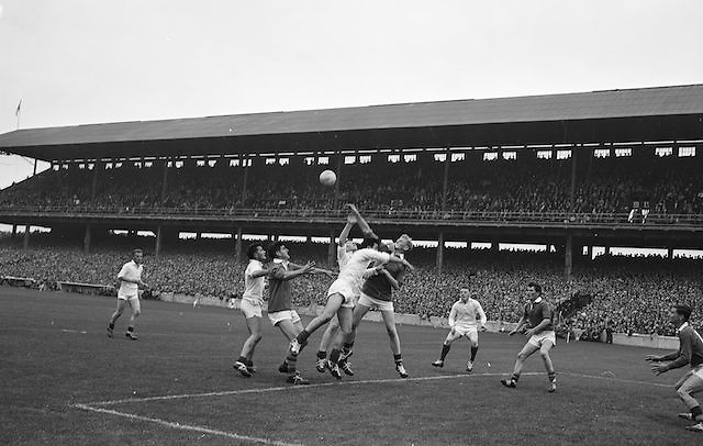 Kerry's P. O'Donohoe fists clear under pressure from Mayo forwards at the All Ireland Minor Gaelic Football Final Kerry v Mayo in Croke Park on the 23rd September 1962. Referee: E. Moules (Wicklow) Attendance: 75,771.