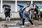 HONG KONG: 06 October 2019 A masked demonstrator throws a rock toward police during clashes in the Causeway Bay area of Hong Kong earlier today. Hundreds of thousands of protesters marched through the city's streets in defiance of the new 'no-mask' law, which was introduced two days ago as demonstrations roll into a 14th week. <br /> Rick Findler / Story Picture Agency