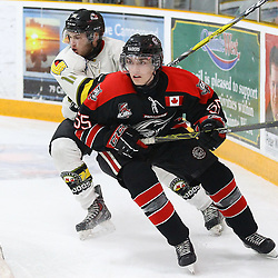 """TRENTON, ON  - MAY 5,  2017: Canadian Junior Hockey League, Central Canadian Jr. """"A"""" Championship. The Dudley Hewitt Cup Game 7 between Georgetown Raiders and the Powassan Voodoos.    Andy Baker #11 of the Powassan Voodoos and Luke Beamish #55 of the Georgetown Raiders battle for position during the first period<br /> (Photo by Alex D'Addese / OJHL Images)"""